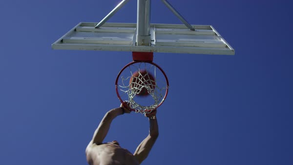 Low angle slow motion shot of man making a slam dunk Royalty-free stock video