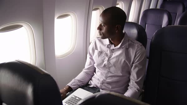Man resting on airplane flight Royalty-free stock video