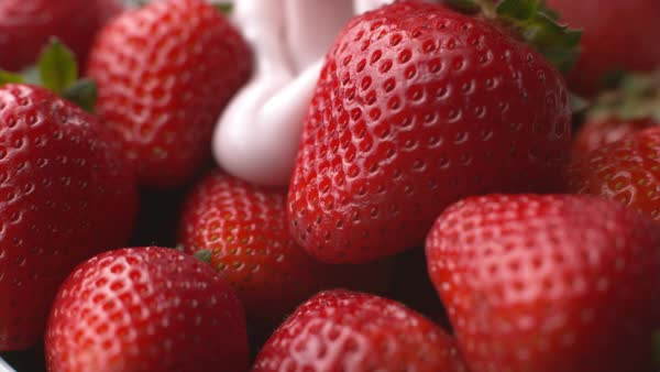 Pouring yogurt onto strawberries in super slow motion Royalty-free stock video