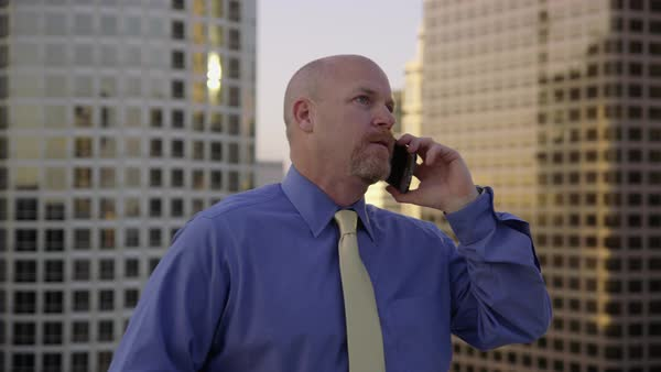 Businessman using cell phone on rooftop in city Royalty-free stock video