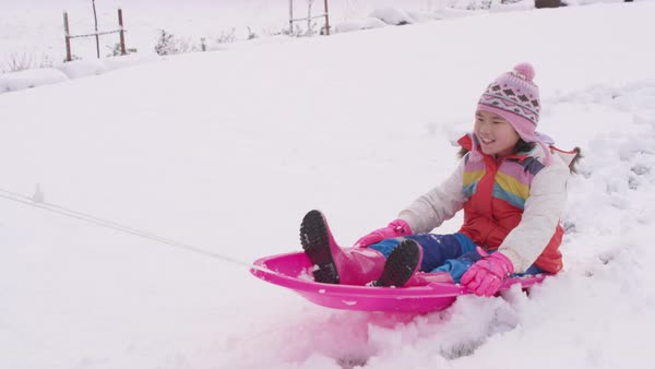 Kids playing and pushing sled in winter snow Royalty-free stock video