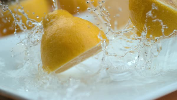 Lemon halves falling into water in super slow motion Royalty-free stock video