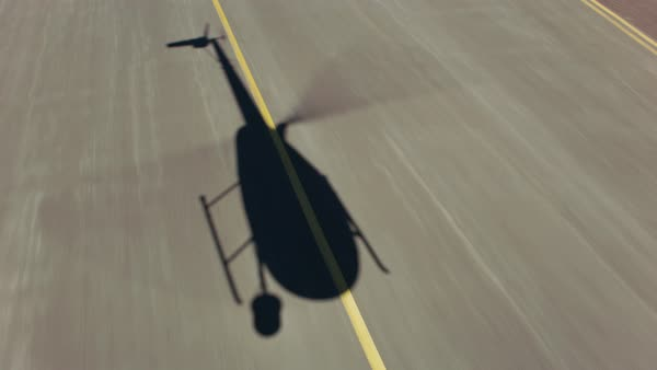Aerial view of helicopter shadow on runway Royalty-free stock video