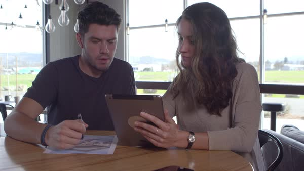 Two young people working together with digital tablet Royalty-free stock video