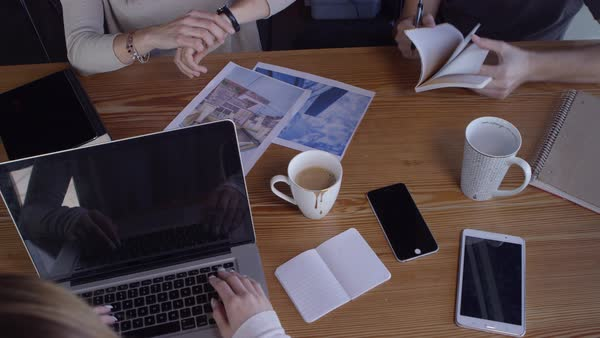 Overhead shot of young business people working together in casual workspace Royalty-free stock video