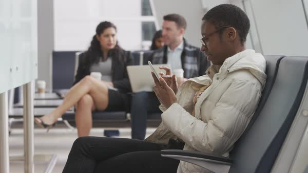 Woman using cell phone at airport Royalty-free stock video