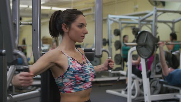 Young woman working out at gym Royalty-free stock video