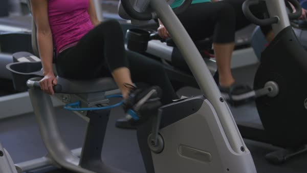 Close-up of woman on exercise bike at gym Royalty-free stock video