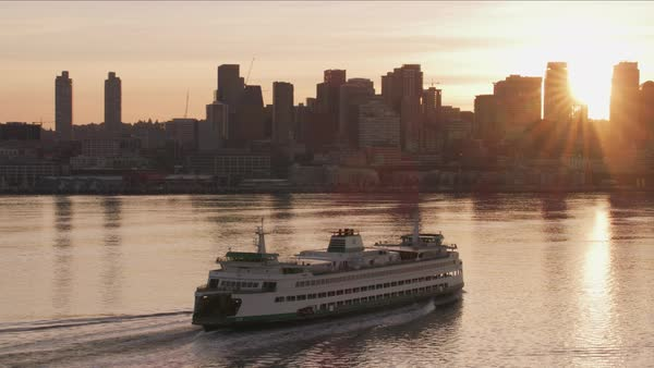 Ferry heading towards Seattle at sunrise.   Royalty-free stock video