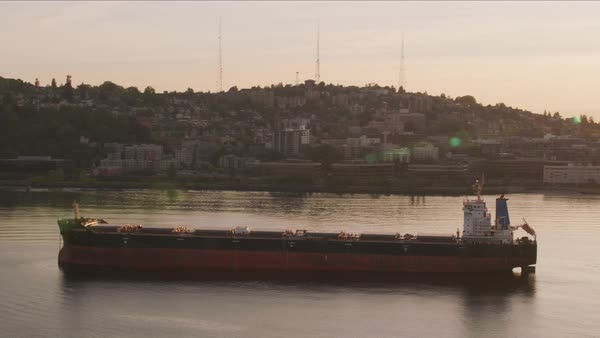 Large ship in front of Seattle skyline at sunrise.   Royalty-free stock video