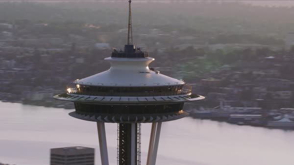 Close-up aerial view of Space Needle at sunrise.   Royalty-free stock video