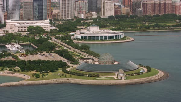 Aerial shot of Adler Planetarium and downtown Chicago.   Royalty-free stock video