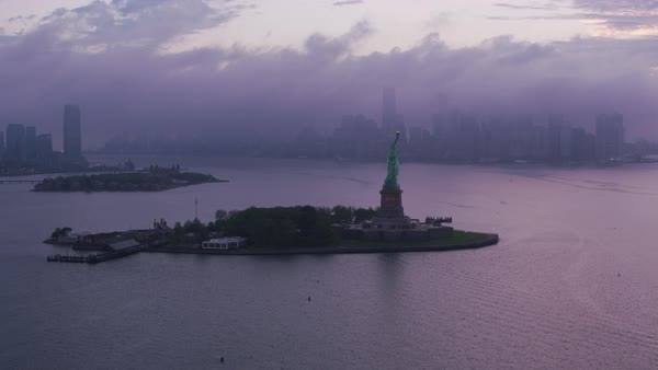 Fly by Statue of Liberty on approach to Manhattan in early morning.    Royalty-free stock video