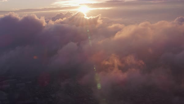 Aerial view of sunrise over clouds with Manhattan below.   Royalty-free stock video