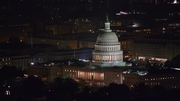Aerial view of the United States Capitol building at night.   Royalty-free stock video