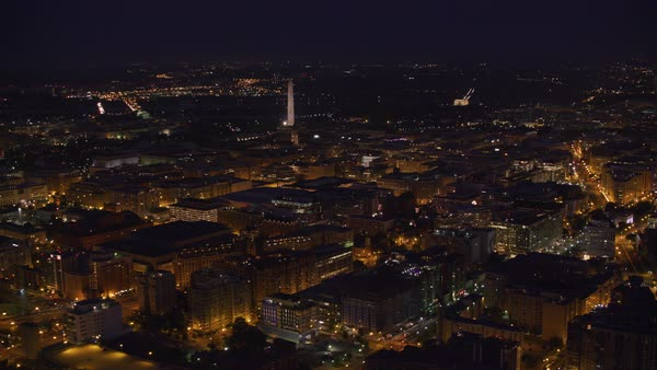 Aerial view of city with Washington Monument in distance.   Royalty-free stock video