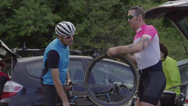 Cyclists fixing tire and preparing bicycle for ride Royalty-free stock video