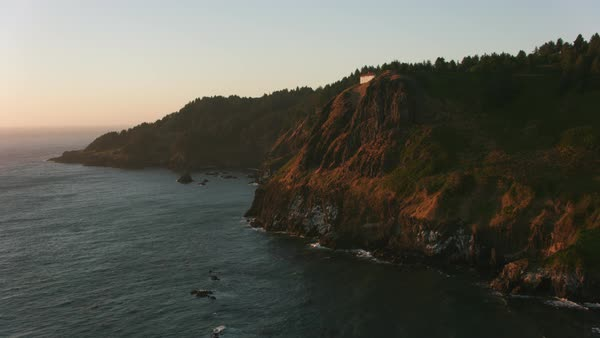 Aerial shot of rocky Oregon Coast at sunset.   Royalty-free stock video
