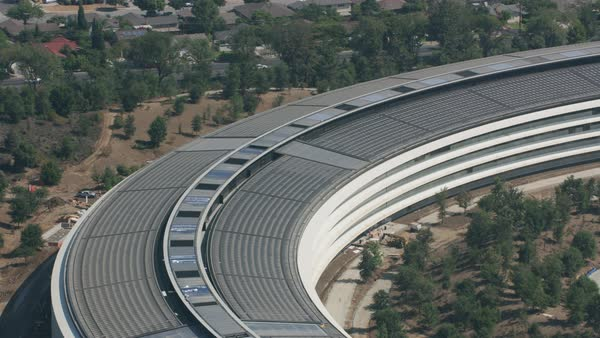 "Aerial view of Apple Park, Apple Inc.'s new headquarters nicknamed ""the spaceship"".   Royalty-free stock video"