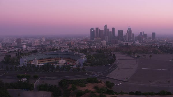 Flying by Dodger Stadium with downtown Los Angeles in distance.   Royalty-free stock video