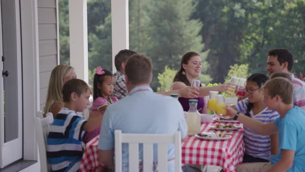 Group of people eating and enjoying a backyard barbeque Royalty-free stock video