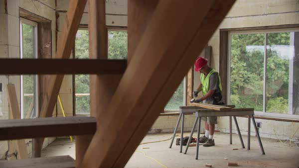 Construction worker inside home working Royalty-free stock video