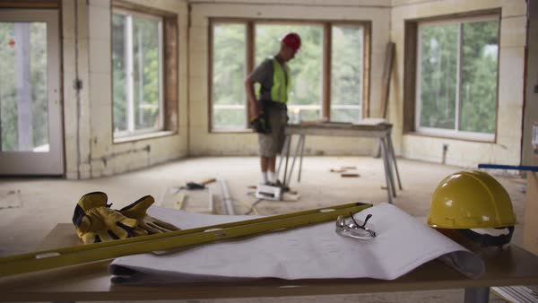 Focus on items in foreground with construction worker in background Royalty-free stock video