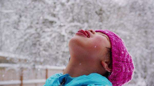 Girl catching snow flakes on tongue Royalty-free stock video