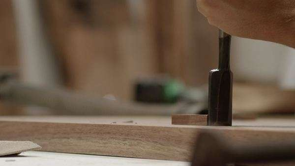 Close-up shot of a carpenter hammering a chisel Royalty-free stock video