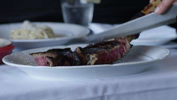 Close-up shot of person slicing a steak Royalty-free stock video