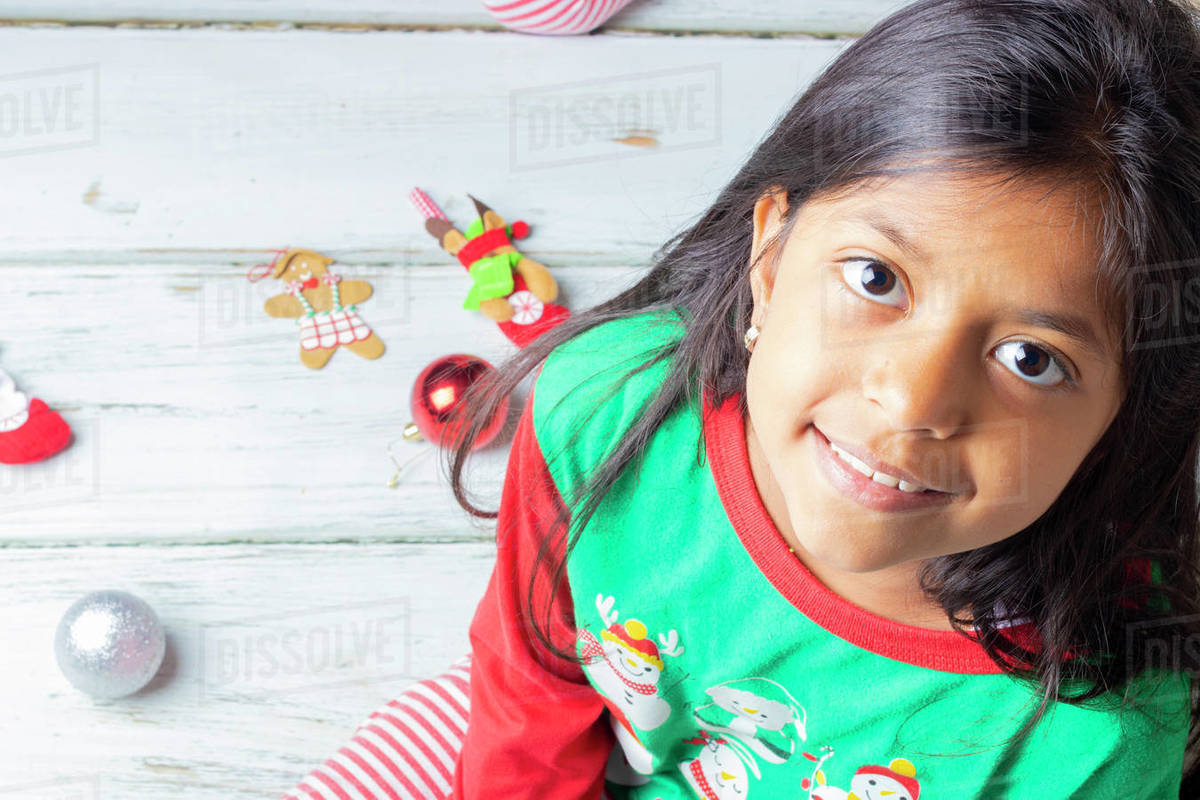 Little brunette girl with Christmas pajamas smiling Royalty-free stock photo