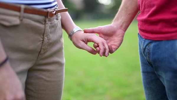 Close-up shot of a couple holding hands Royalty-free stock video