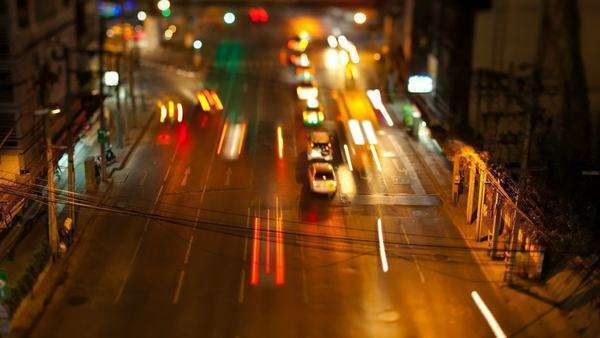 Timelapse: traffic in the city of Bangkok at night. Tilt shift lens. Royalty-free stock video