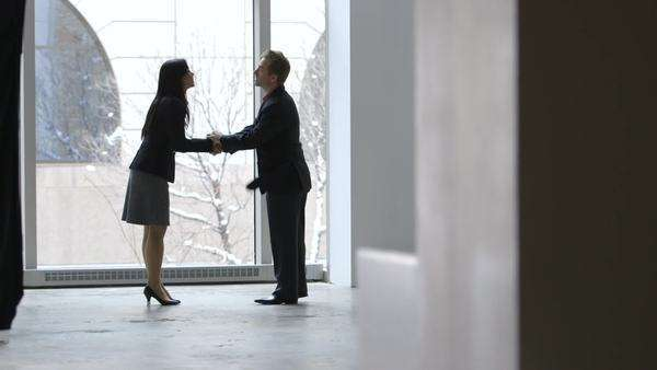 Tracking shot of businesspeople saying goodbye with handshake Royalty-free stock video
