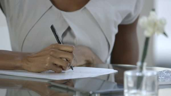 Close-up of businesswoman writing Royalty-free stock video