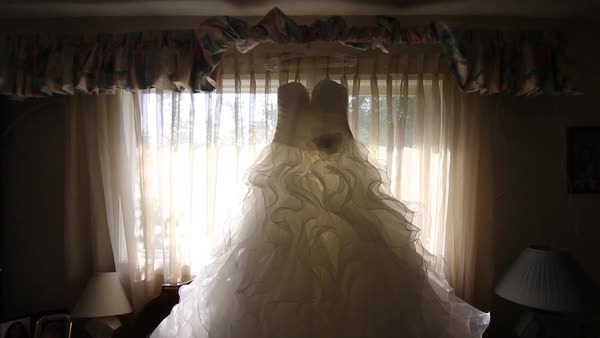 Long shot of a wedding dress in a bedroom Royalty-free stock video