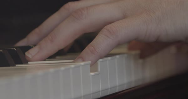 Extreme close-up of person playing a song on the piano Royalty-free stock video