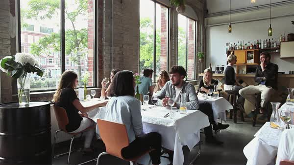 Many Young People Sitting and Talking in Stylish Restaurant Royalty-free stock video