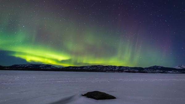 Timelapse of Aurora over frozen Lake Laberge in Yukon, Canada Royalty-free stock video