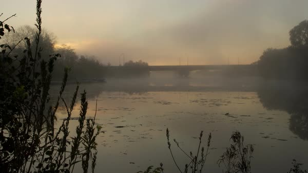 Sunrise over a mist-covered Huron River in Michigan, USA. Timelapse. Royalty-free stock video