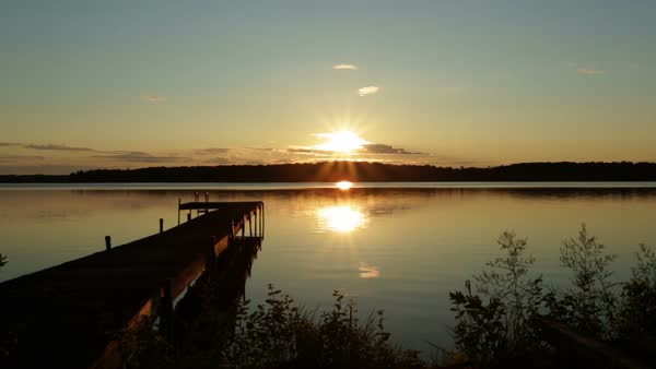Sunrise over a small lake in Michigan, USA. Royalty-free stock video