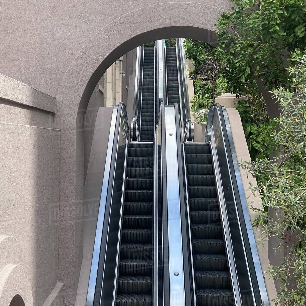 LOS ANGELES, CA, MAR 2020: escalators rising up through archways next to the US Bank Tower in Downtown Royalty-free stock photo