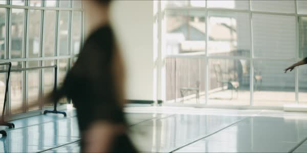 Hand-held shot of a ballerina practicing in front of a mirror Royalty-free stock video