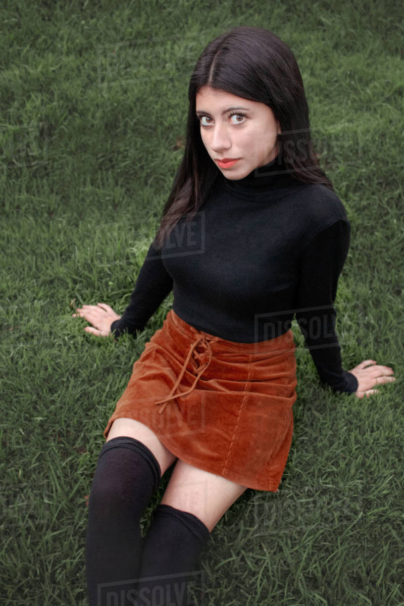 Beautiful young woman posing with grass background Royalty-free stock photo
