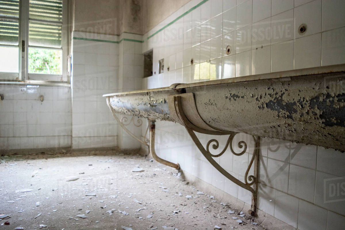 Decay sink in old abandoned destroyed building Royalty-free stock photo