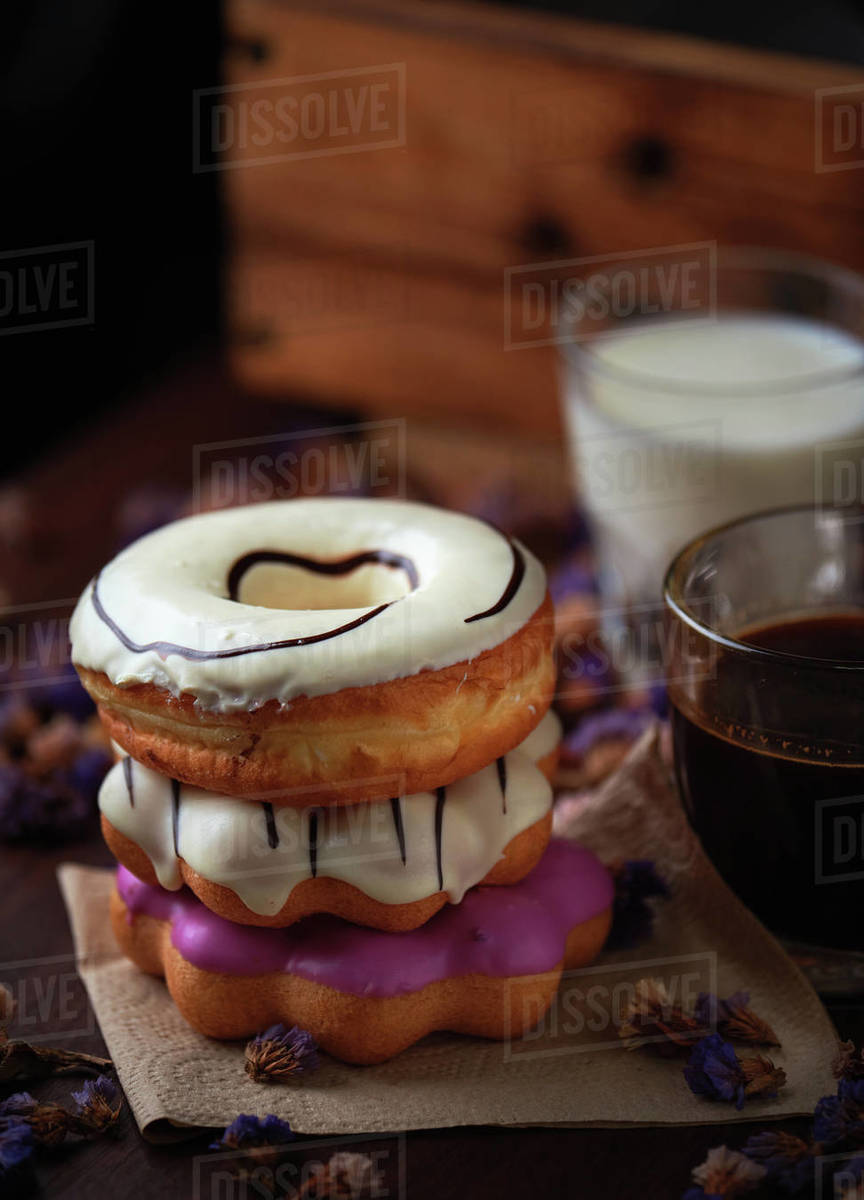 Sweet glazed donuts stacked on a table Royalty-free stock photo