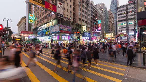 Time lapse of pedestrians and traffic at a busy road crossing, Nathan Road, Kowloon, Hong Kong, China Royalty-free stock video
