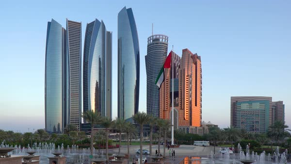 Etihad Towers viewed over the fountains of the Emirates Palace Hotel, Abu Dhabi, United Arab Emirates, Middle East Royalty-free stock video