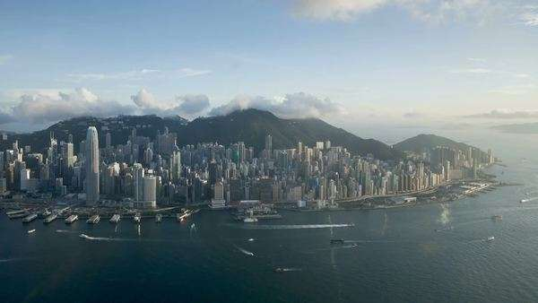 Aerial view over Hong Kong Island towards Victoria Peak showing the busy Victoria Harbour and Financial District of Central, Hong Kong, China, Timelapse Royalty-free stock video