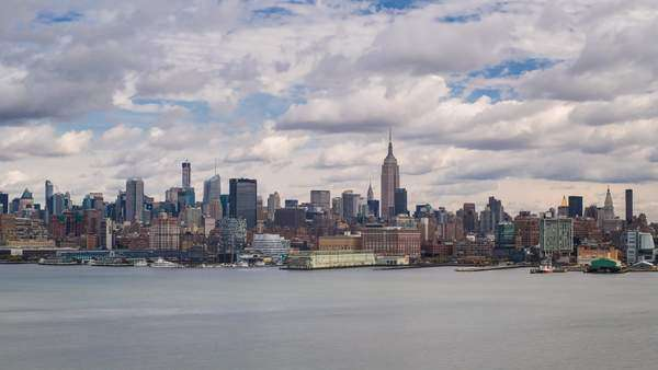 Manhattan, view of the Empire State Building and Midtown Manhattan across the Hudson River, New York, United States of America - timelapse Royalty-free stock video